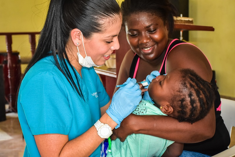 dentist checking babies teeth in village of Bonao