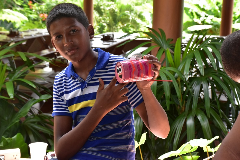 boy with finishes art on Rancho Iguana in Anamuya
