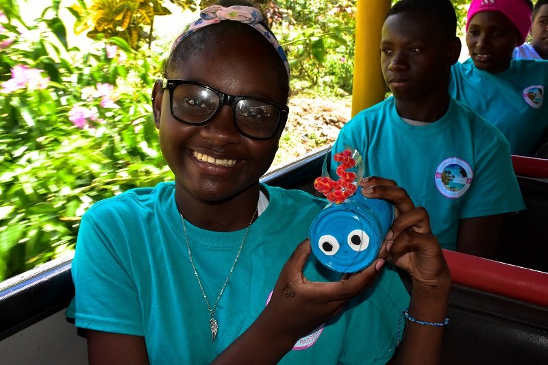 girls with handmade recycled craft on Outback Safari truck in Punta Cana