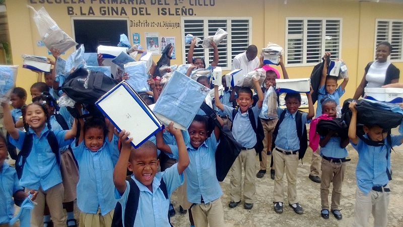 children at school with school donation in Punta Cana