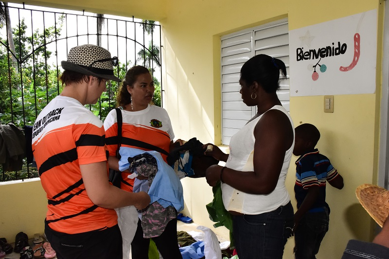 women selling clothing for fundraiser in Bonao
