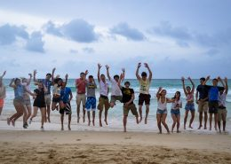 group jumping in the air on Macao Beach, Dominican Republic
