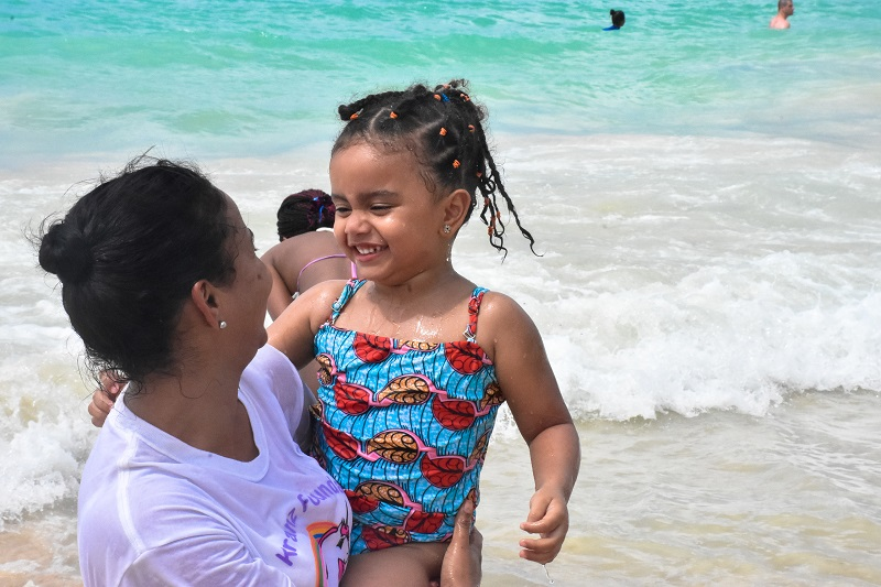 little girl having fun at the beach in Macao