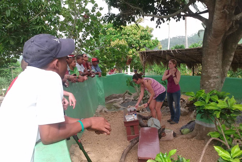 scheintist watching demonstration on Iguana handeling in Anamuya, Dominican Republic