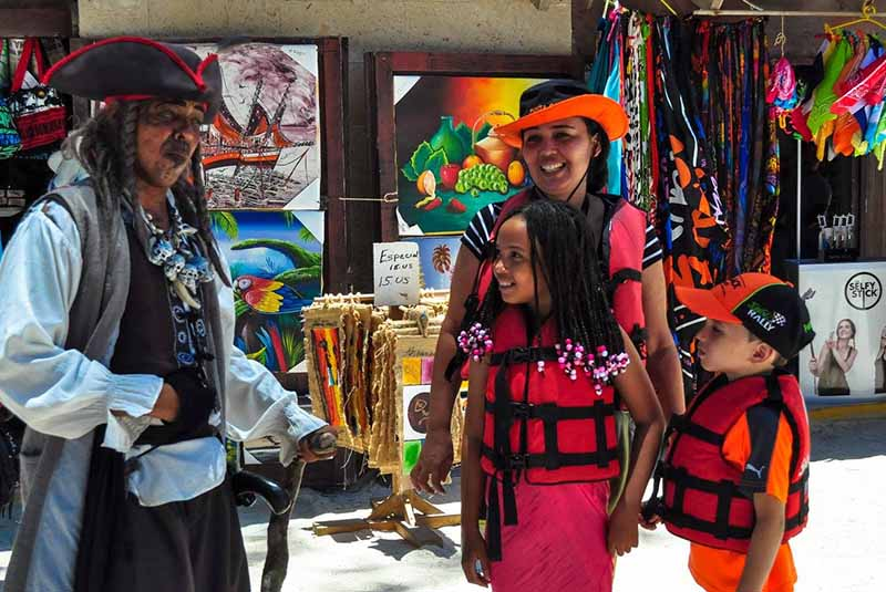 Family having fun with pirate from Ocean Adventure tour - Dominican Republic