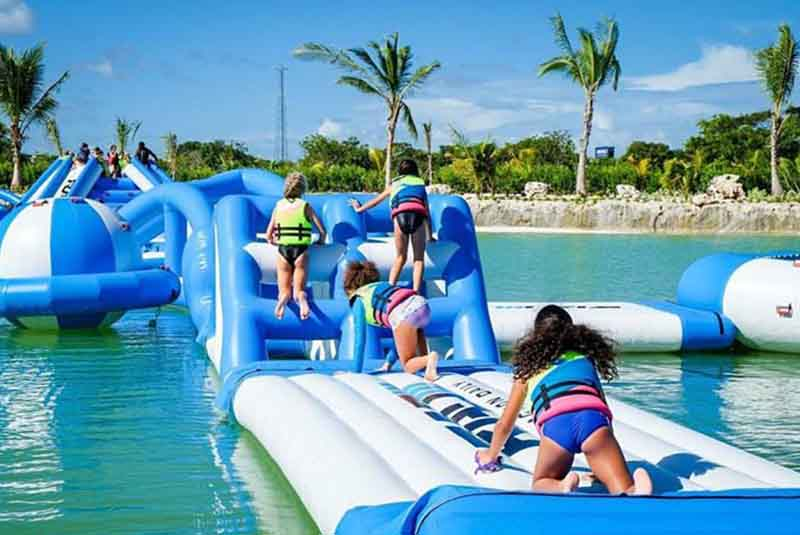 children having fun on inflatable floating island - Punta Cana