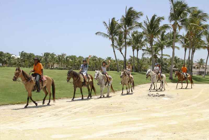 group riding horses with guide in Punta Cana