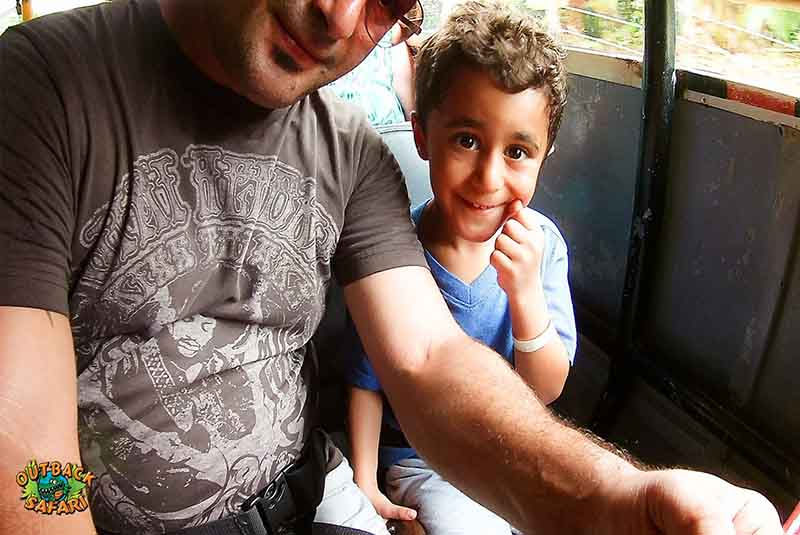 father and son riding on Outback Safari truck in Punta Cana -Outback Adventures