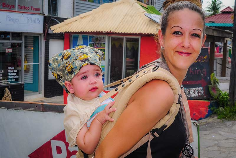 women with baby in carrier- Dominican Republic