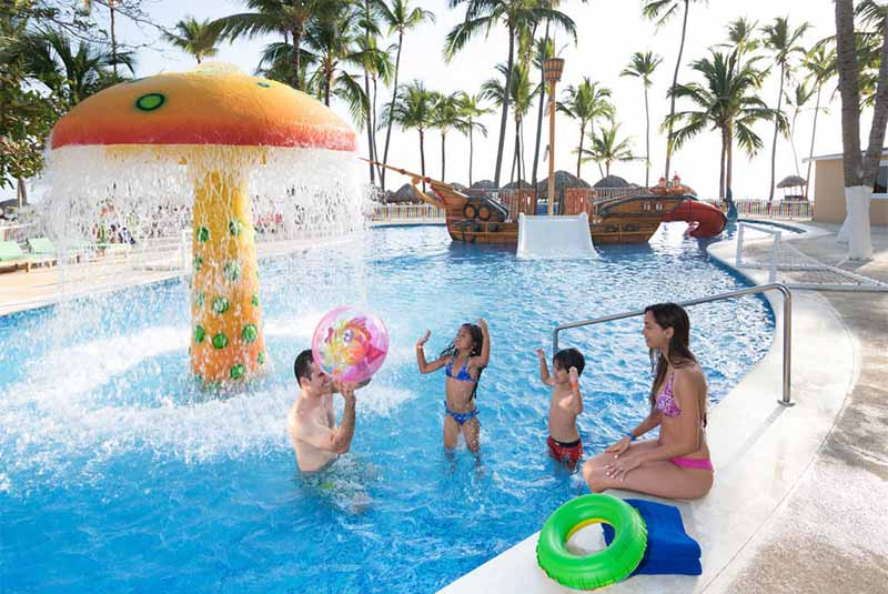 family in hotel pool in Punta Cana - Dominican Republic