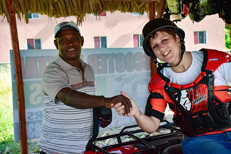 man and woman hand shacking in ATV rental place in Bavaro - Punta Cana