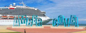 Carnival Cruise ship behind Amber Cove sign in Puerto Plata's cruise ship port - Dominican Republic