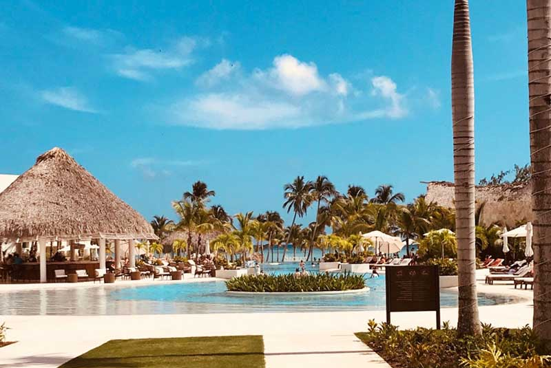 pool area with bar at Secrets Cap Cana hotel in Dominican Republic