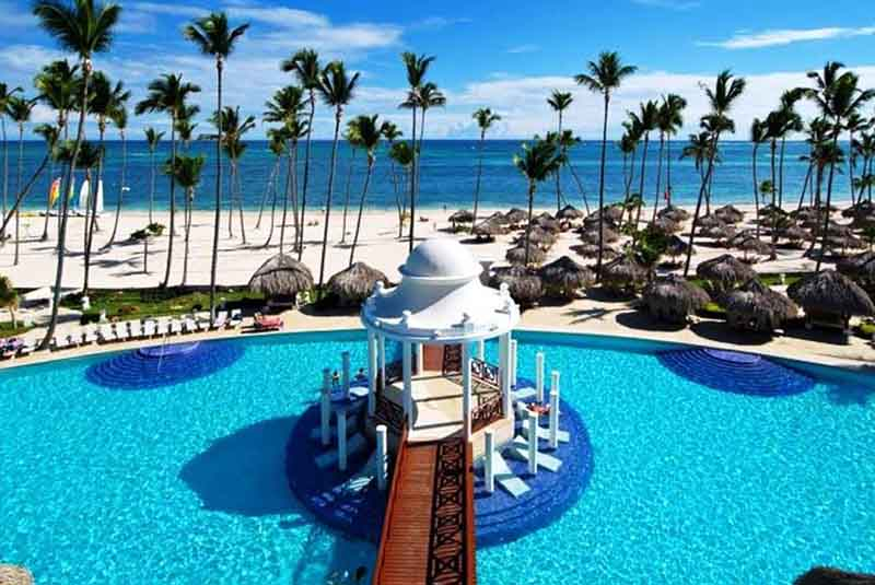 pool area and hotels beach view in Paradisus Palma Real in Punta Cana