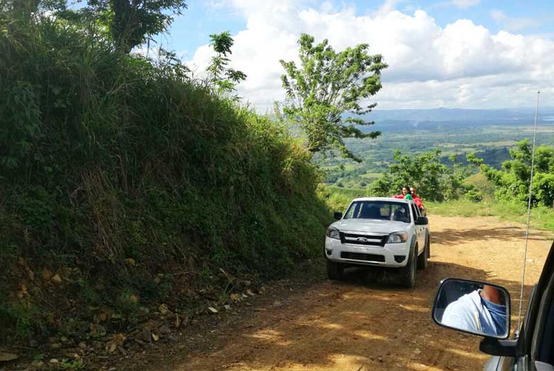 car driving up narrow road to Montaña Redonda in Miches - Dominican Republic
