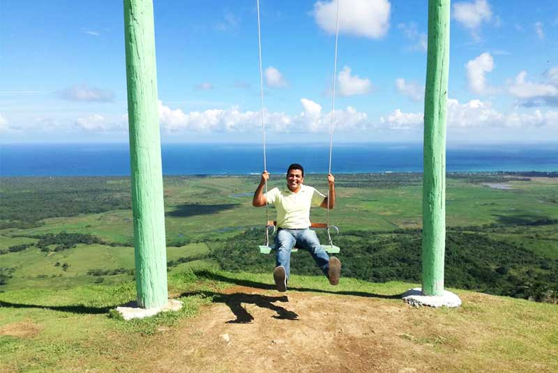 Montaña Redonda - Man taking swing on mountain top in Miches - Dominican Republic