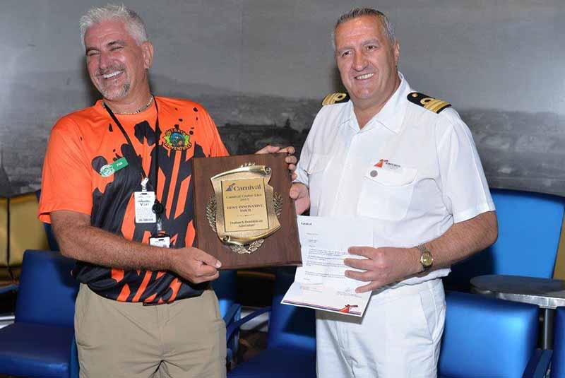 Outback Adventures owner receiving award from captain of Carnival Cruise Ship