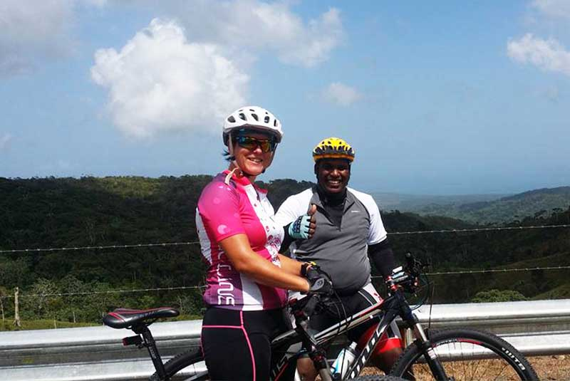 Outback Adventure staff riding with man mountain bike in Pedro Sanchez - Dominican Republic