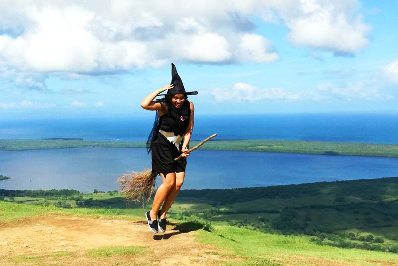 Women in witch costume taking picture on broom on Montaña Redonda in Miches - Dominican Republic