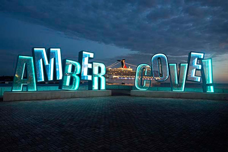 lit up Amber Cove sign at cruise port in Puerto Plata - Dominican Republic