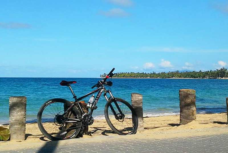 mountain bike on beach in Las Terrenas -Dominican Republic