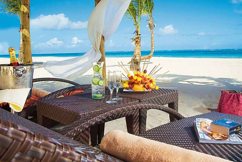 beach loungers with food and beverage service in Secrets Hotels in Uvero Alto