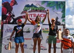 female mountain biker on podium after mountain bike race in Punta Cana
