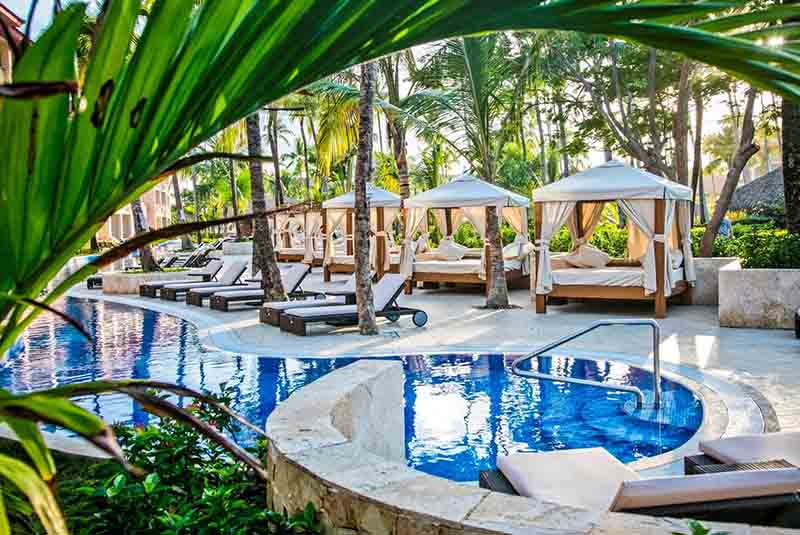 pool area with Bali beds in Majestic Colonial hotel in Punta Cana