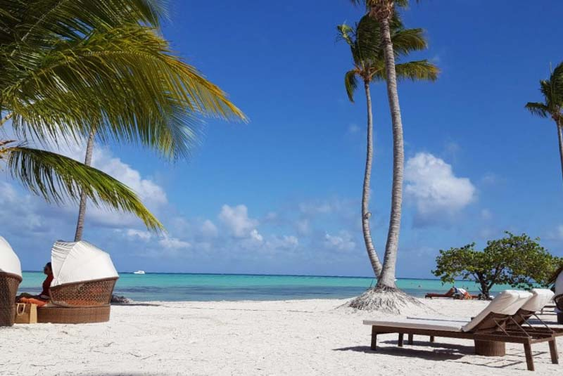 beach with loungers at Secrets Cap Cana resort in Dominican Republic
