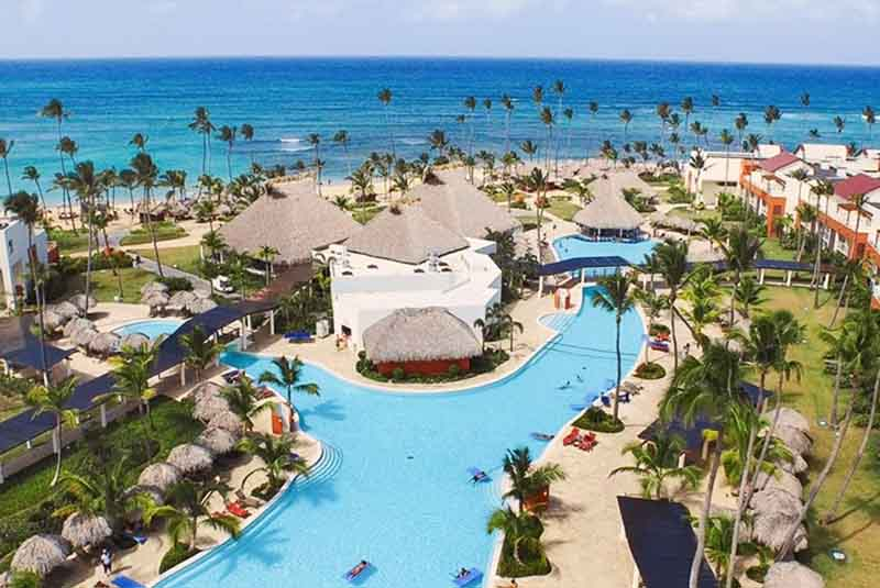hotels pool area and beach view in Breathless Punta Cana in Uvero Alto - Dominican Republic