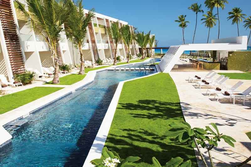 Now Onix hotels pool area with beach view - Punta Cana
