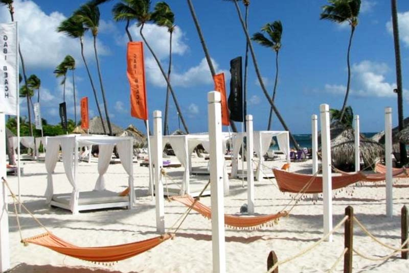 Bali beds and hammocks at Gabi beach on beach of Paradisus Palma Real hotel in Punta Cana