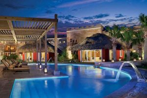 pool area at night at Sanctuary hotel in Cap Cana