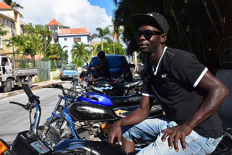 man sitting on motorcycle in Bavaro - Punta Cana
