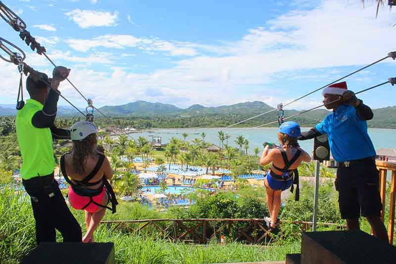 two woman zip lining in Amber Cove - Puerto Plata