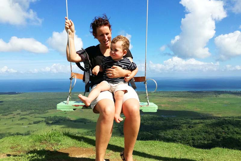 Women with child on swing on top of Montaña Redonda in Miches - Dominican Republic