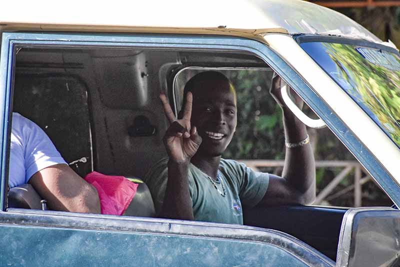 bus driver showing peace sign in Bacaro- Punta Cana