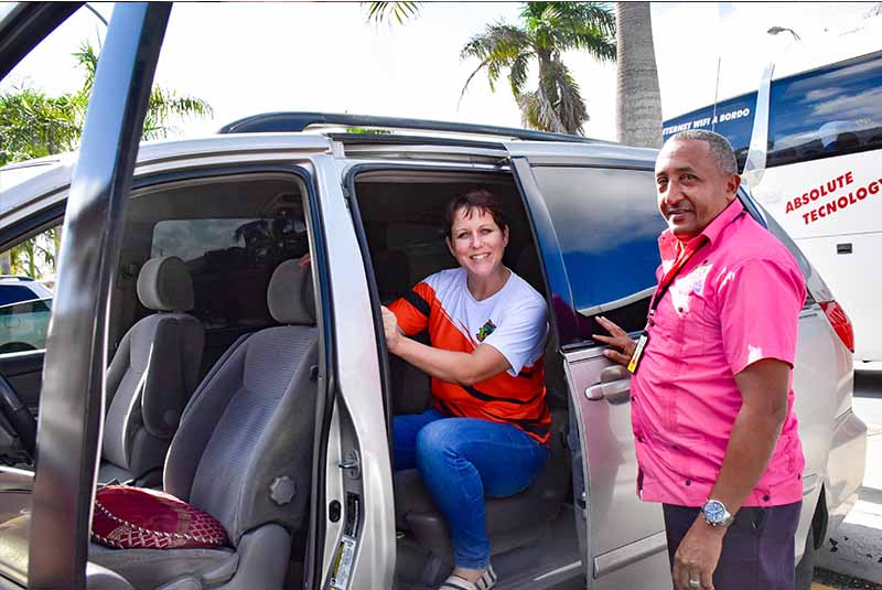 women sitting in local taxi in Bavaro - Punta Cana