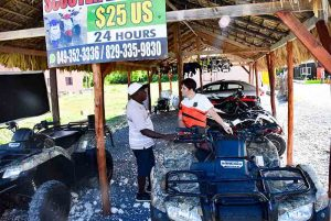 Outback Adventures staff getting information from man owning local scooter and ATV rental place in Bavaro - Punta Cana