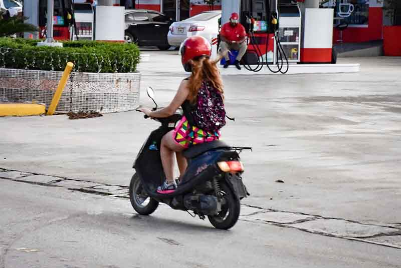woman driving a scooter in Bavaro - Punta Cana