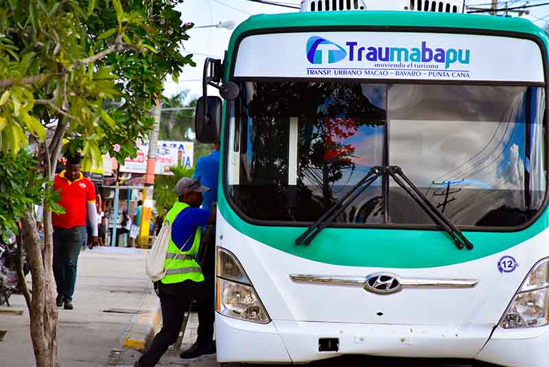 man boarding local bus in Punta Cana - Dominican Republic