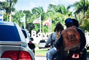 motorcycle driver with orange west in Punta Cana -Dominican Republic
