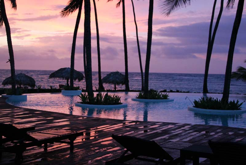 Pool view with sunset on beach of Zoetry Agua hotel in Uvero Alto - Dominican Republic