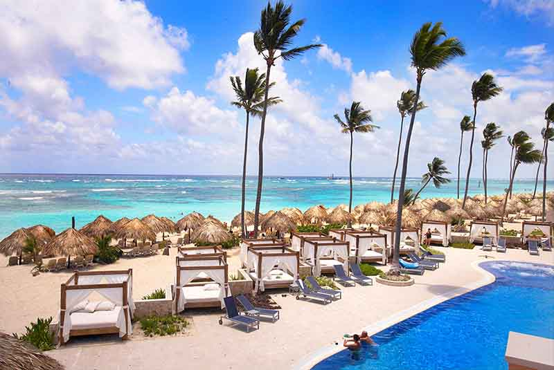 beach beds and beach view from Majestic Elegance in Punta Cana - Dominican Republic