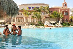 couples enjoying a drink at pool in Sanctuary hotel in Cap Cana