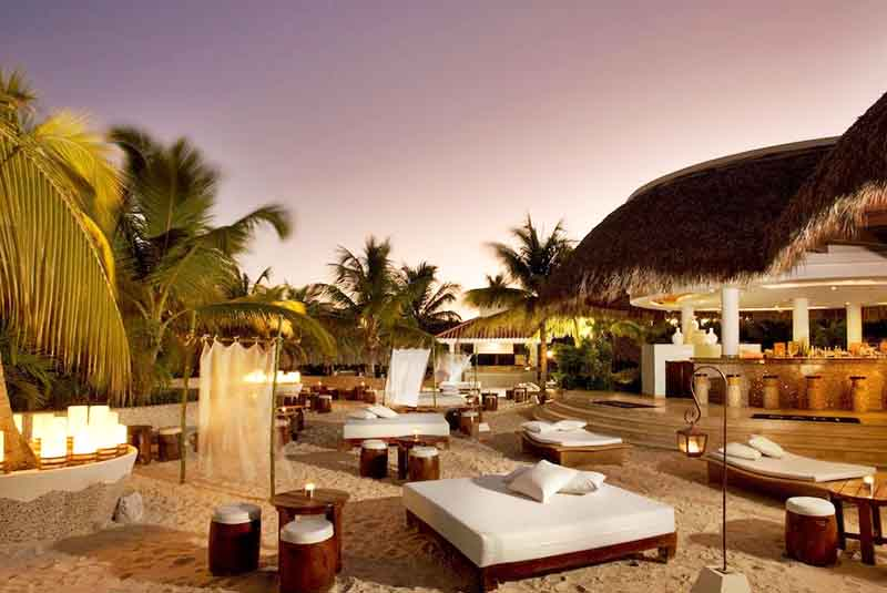 Beach area with sun beds at Melia Caribe hotel in Punta Cana