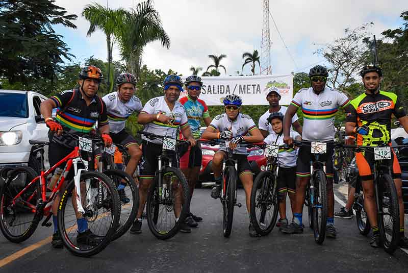 mountain bike team posing on finish line in Anamuya - Punta Cana