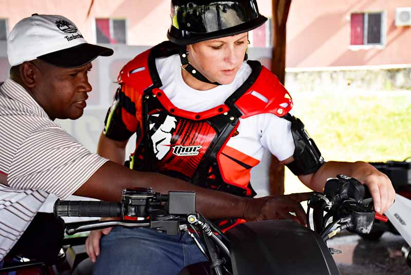 man explaining woman use of ATV in Bavaro - Punta Cana