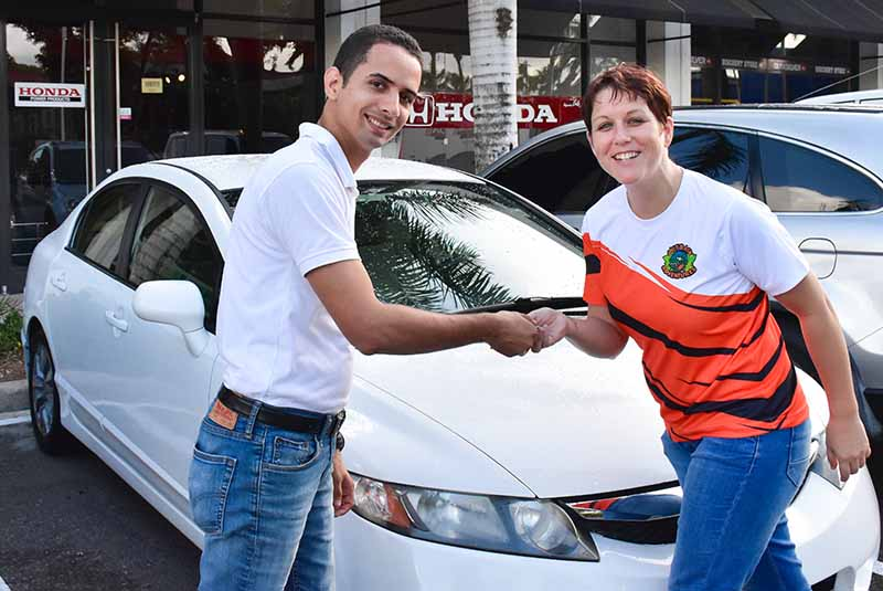 Outback Adventures staff getting keys for rental car from man in Bavaro - Punta Cana