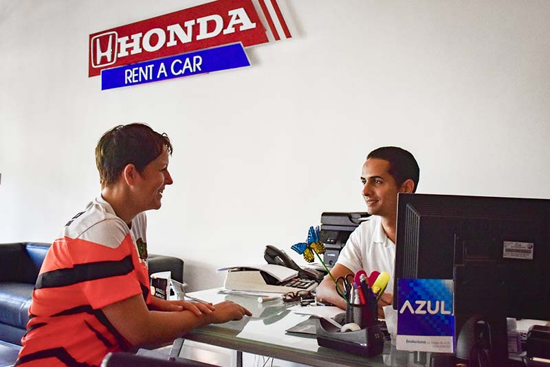 woman sitting with man in rental car office in Punta Cana - Dominican Republic